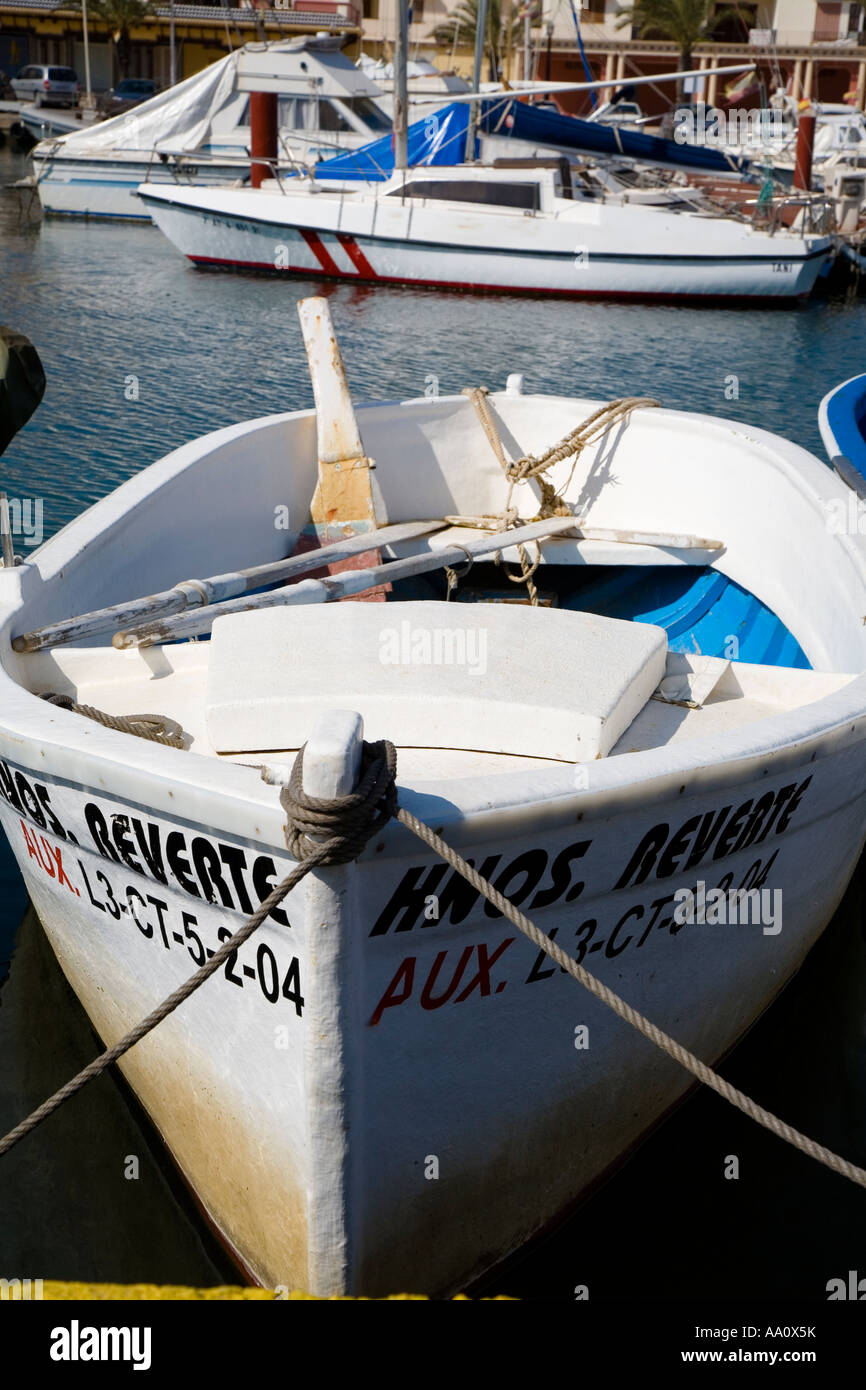 Small Spanish fishing boat moored in harbour harbor - Stock Image