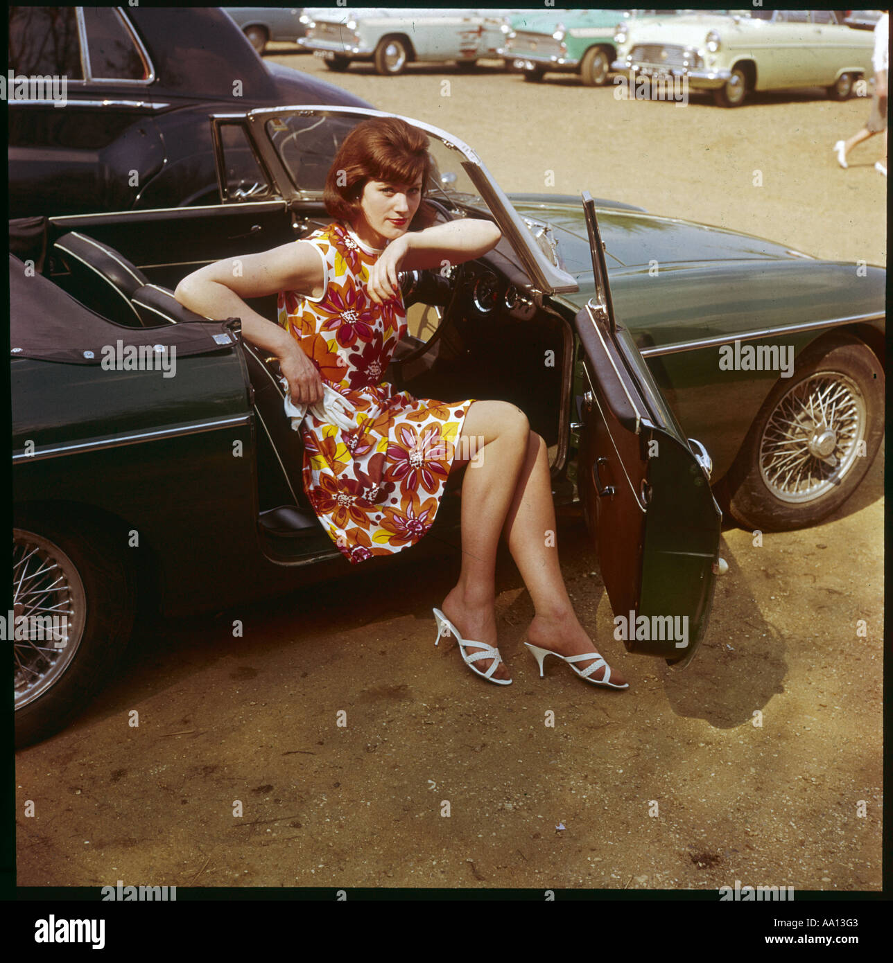 Girl In Mgb 1960s - Stock Image