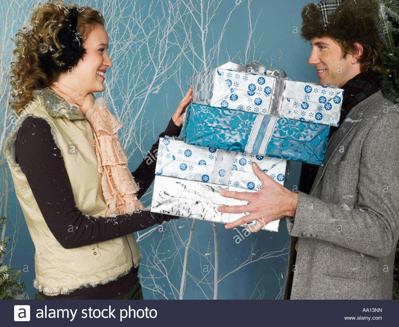 Couple with presents - Stock Image