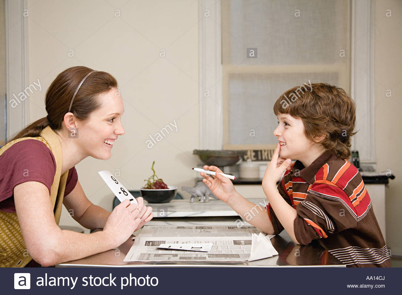Mother helping son with mathematics - Stock Image