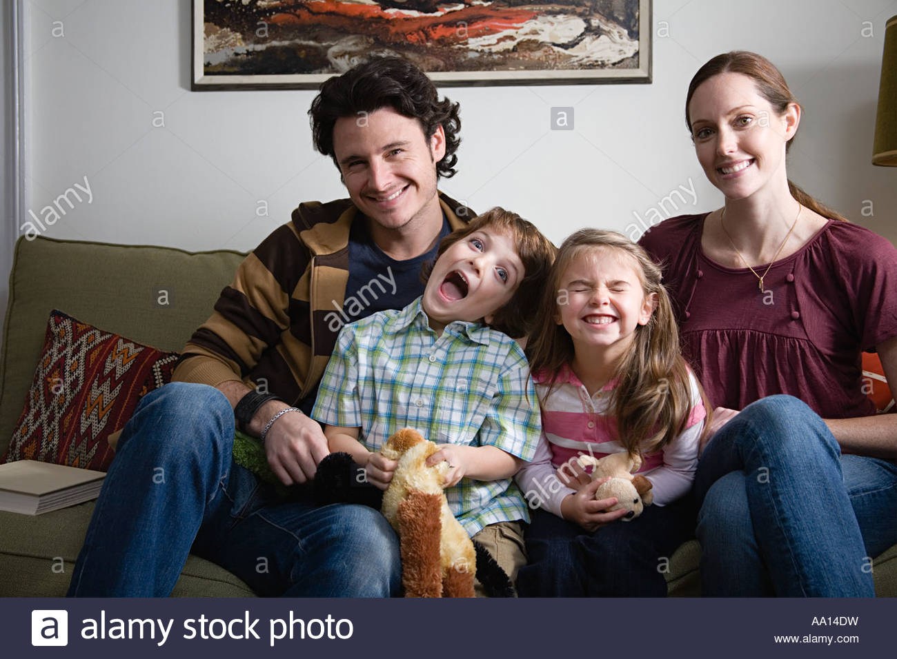 Cheeky children in family portrait - Stock Image