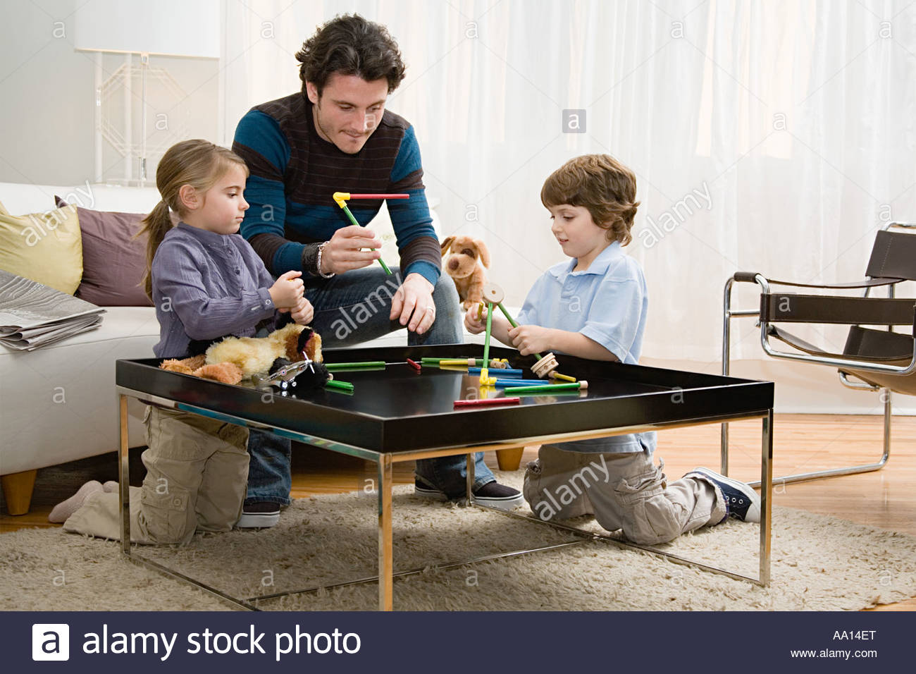 Father and kids playing game Stock Photo