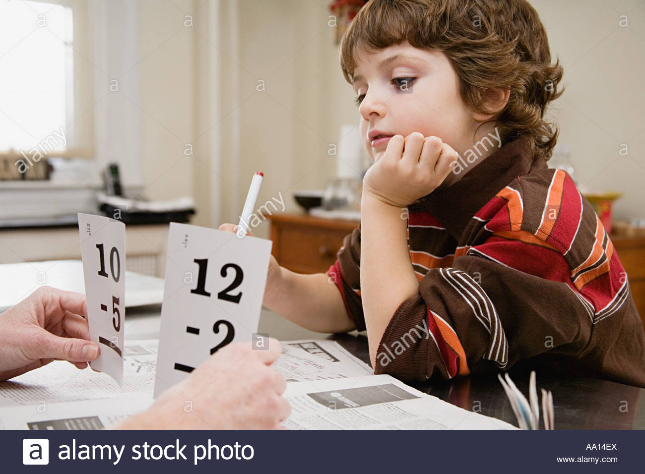 Boy learning mathematics - Stock Image
