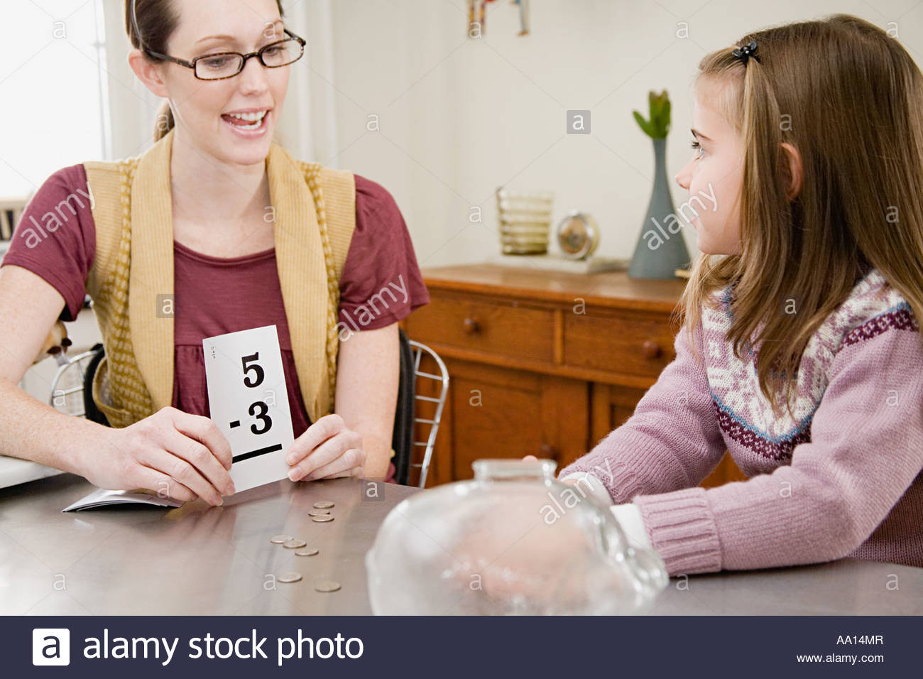 Mother helping daughter with mathematics - Stock Image