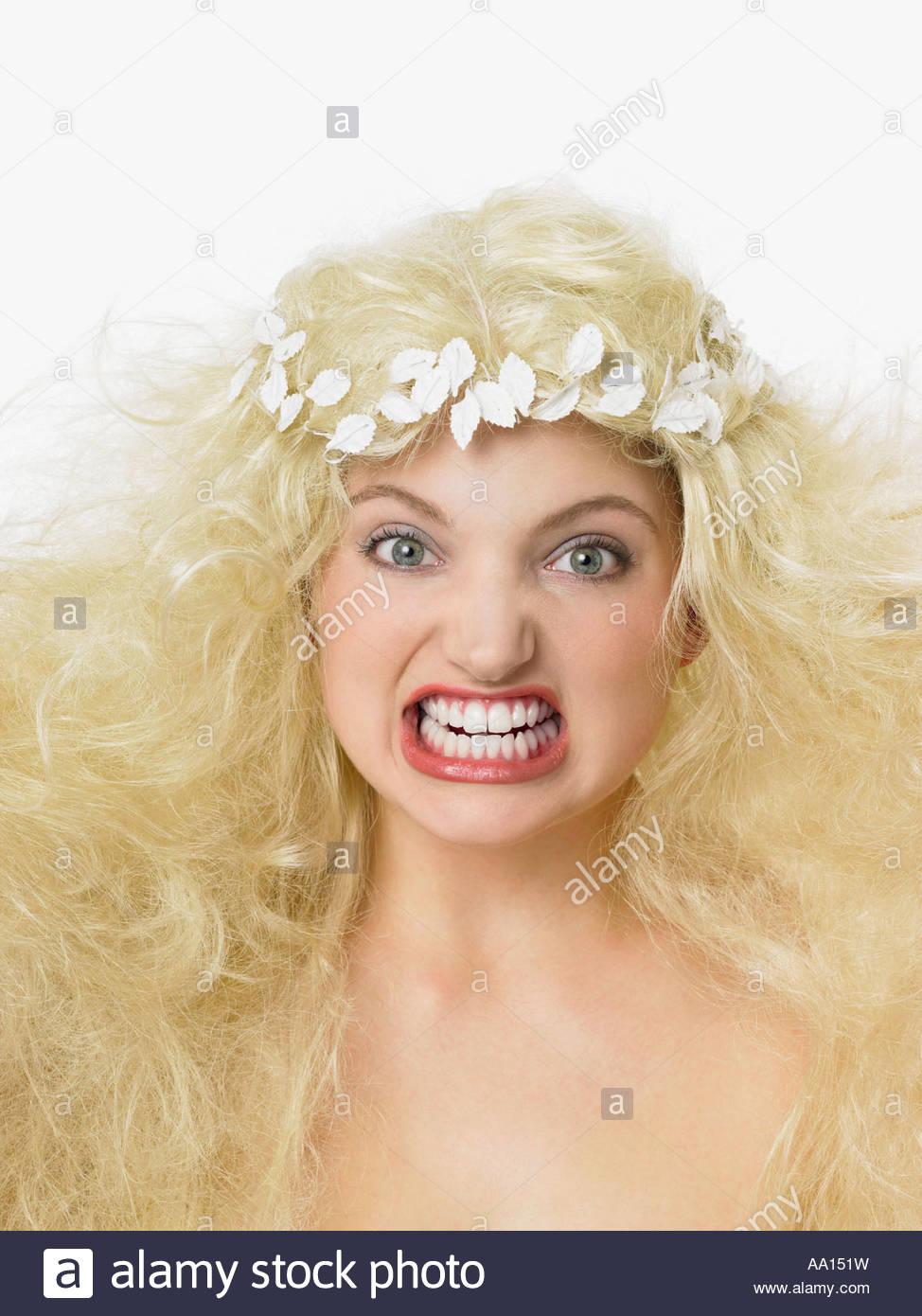 Woman grimacing - Stock Image