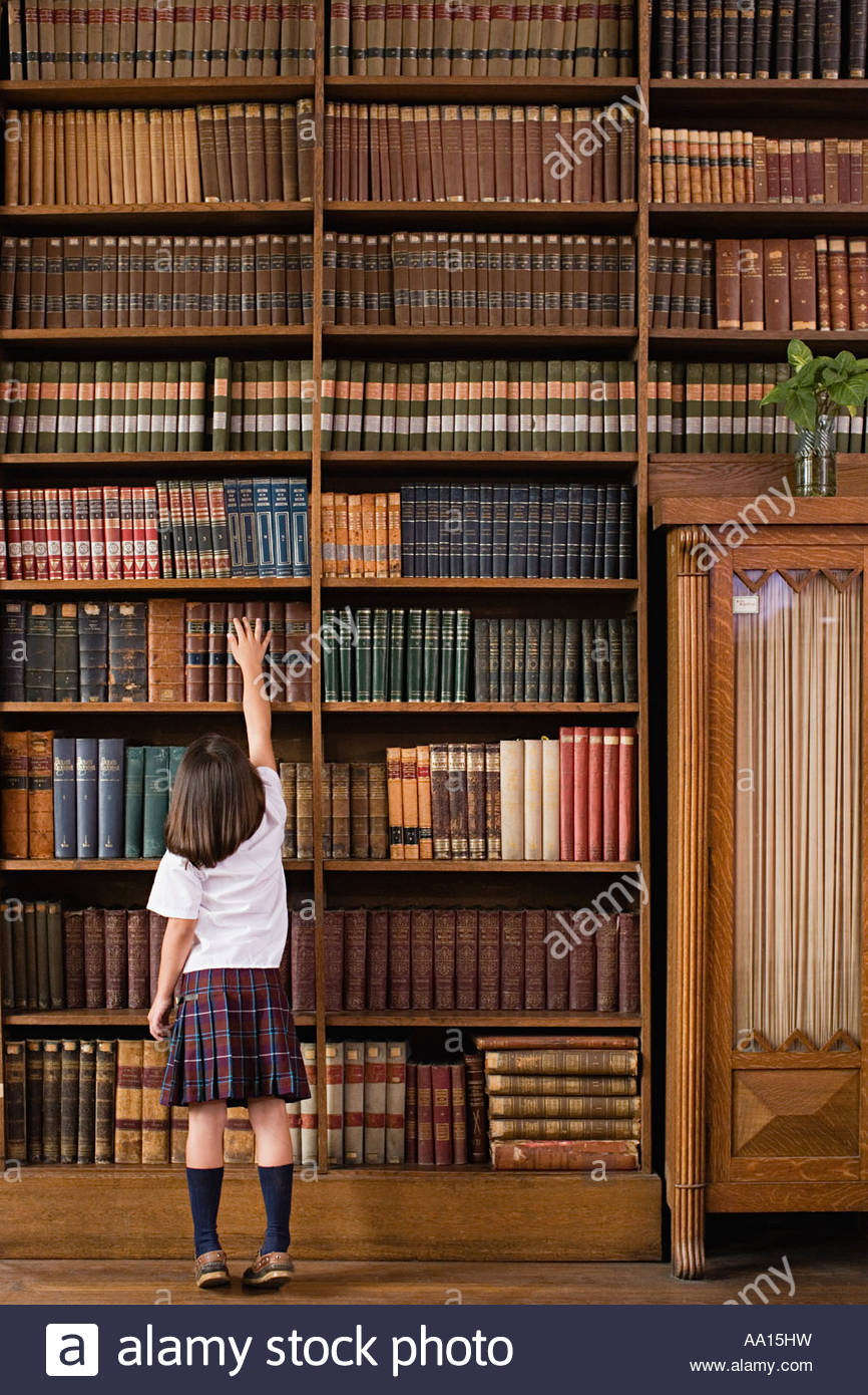 Girl in a library - Stock Image