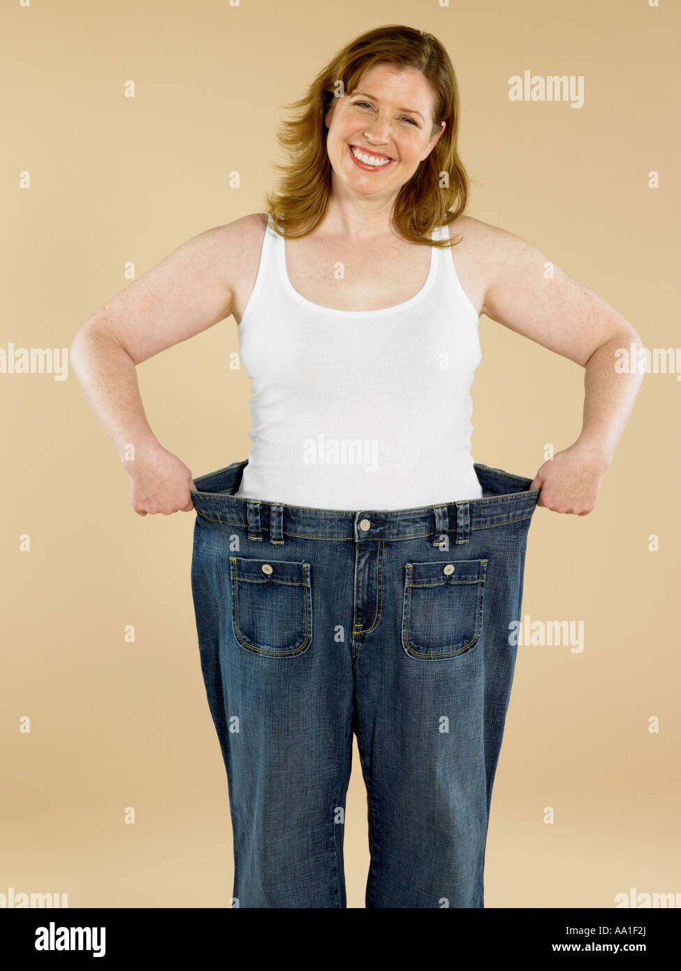 Woman with loose jeans - Stock Image