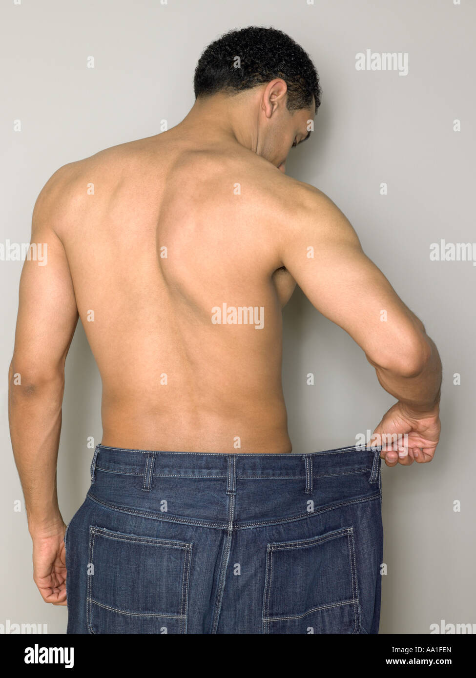 Man with loose jeans - Stock Image