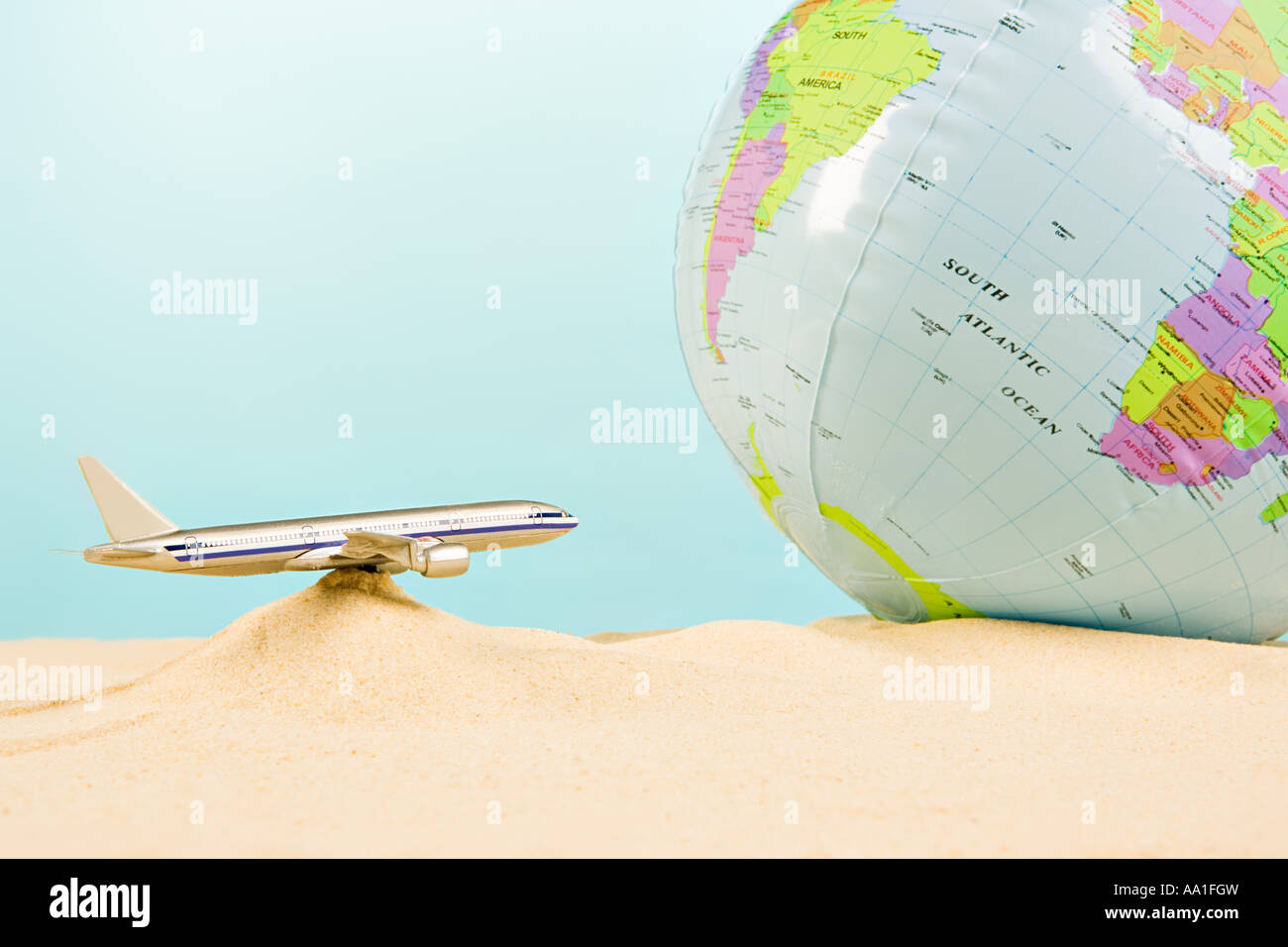 Model aeroplane and globe - Stock Image