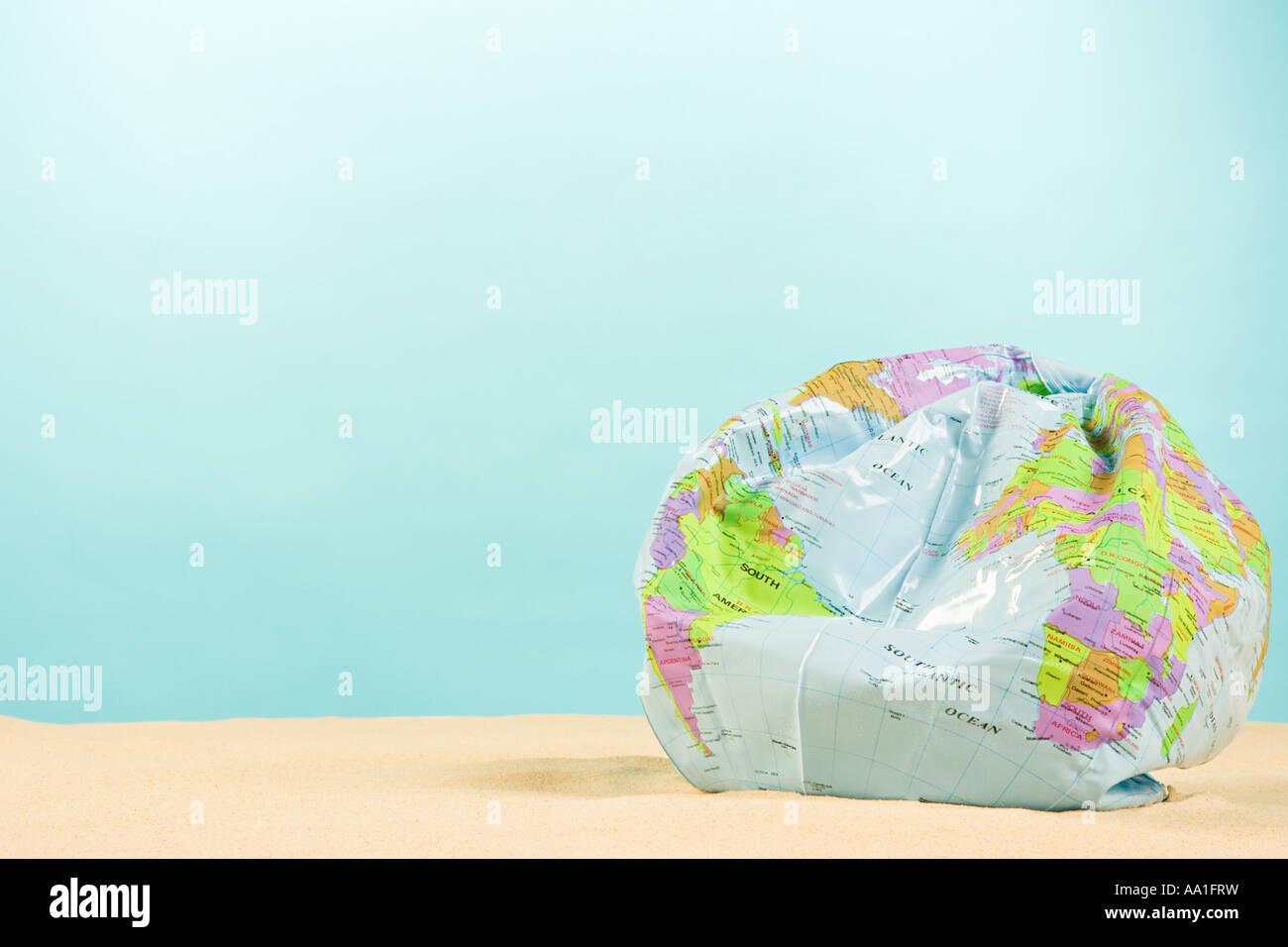 Deflated globe - Stock Image