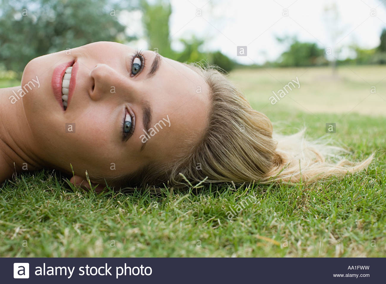 Woman lying down - Stock Image