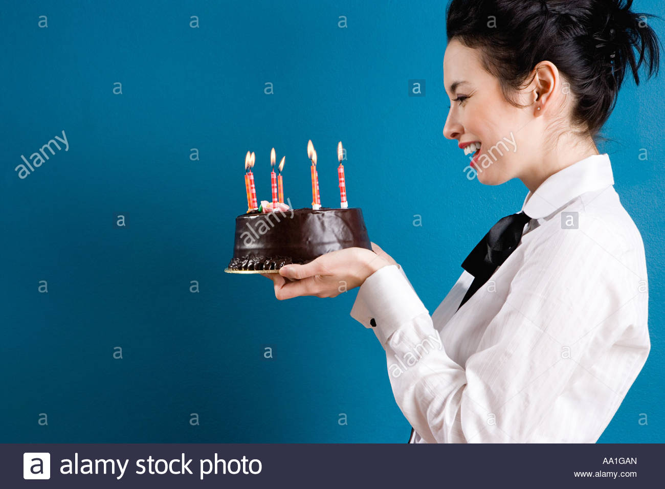 Young Woman Holding A Birthday Cake