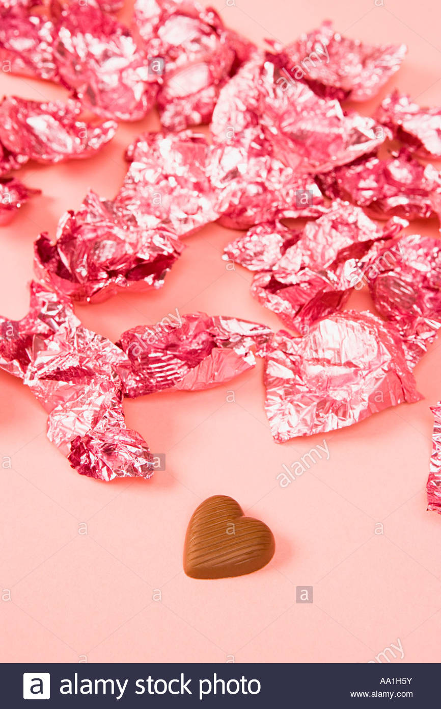 Chocolate and wrappers - Stock Image