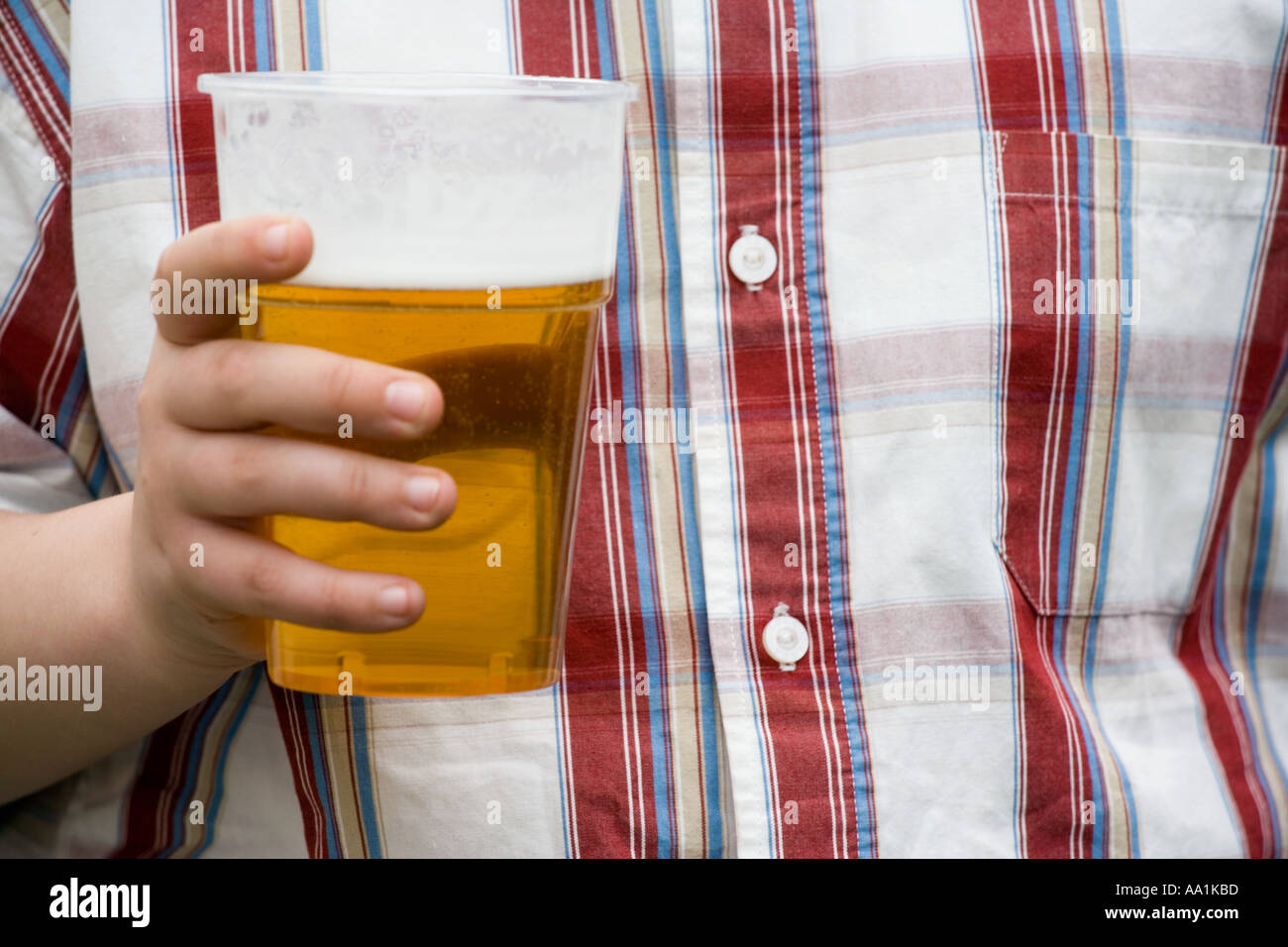 YOUNG BOY HOLDING A PINT OF BEER - Stock Image