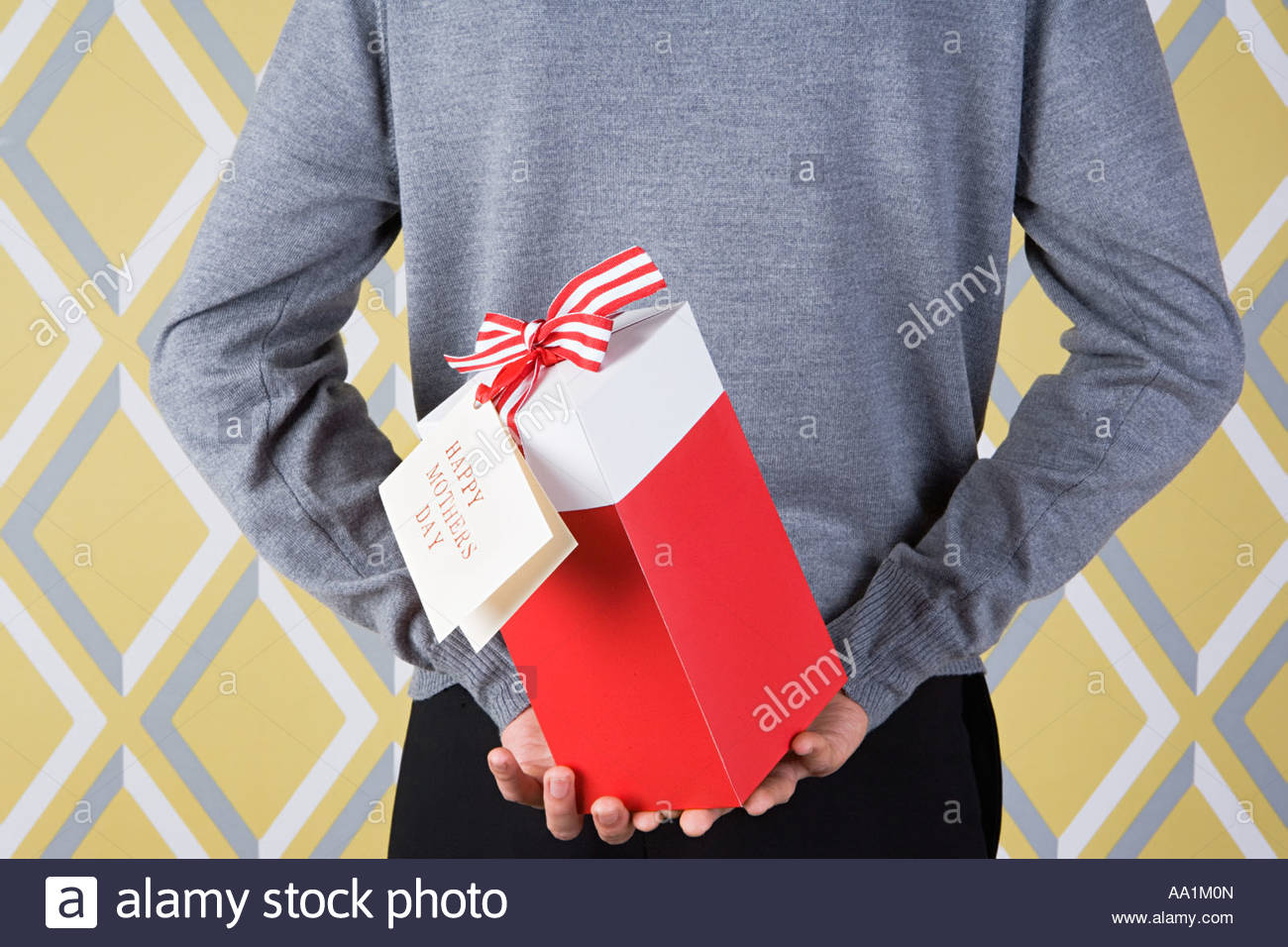 Man holding mothers day gift - Stock Image