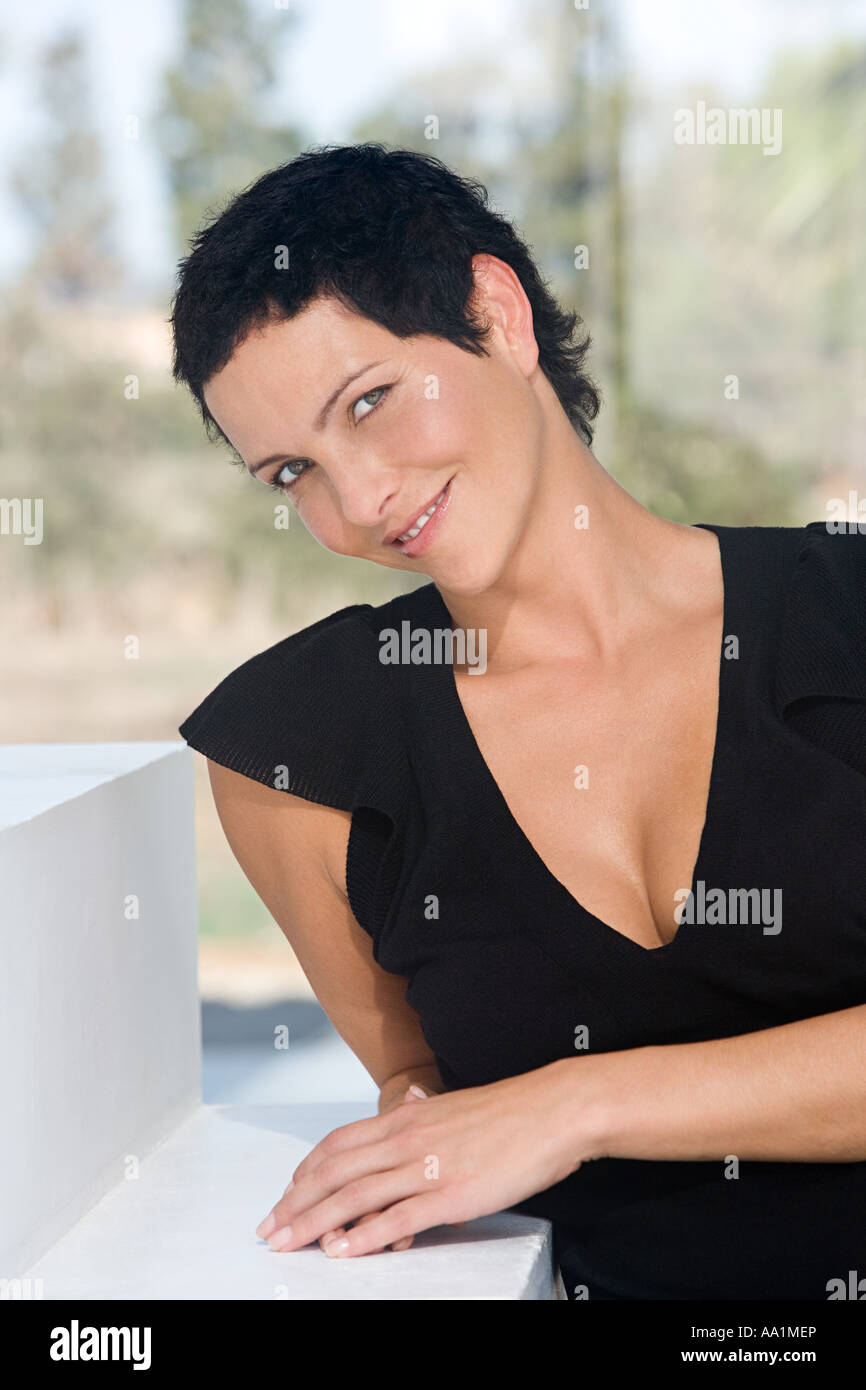 Woman leaning on step - Stock Image