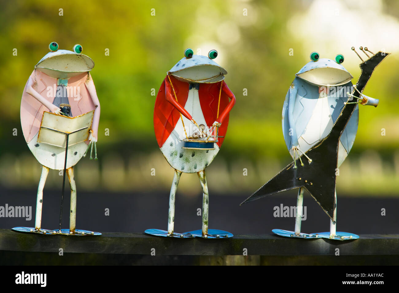 Frogs playing musical instruments - Stock Image