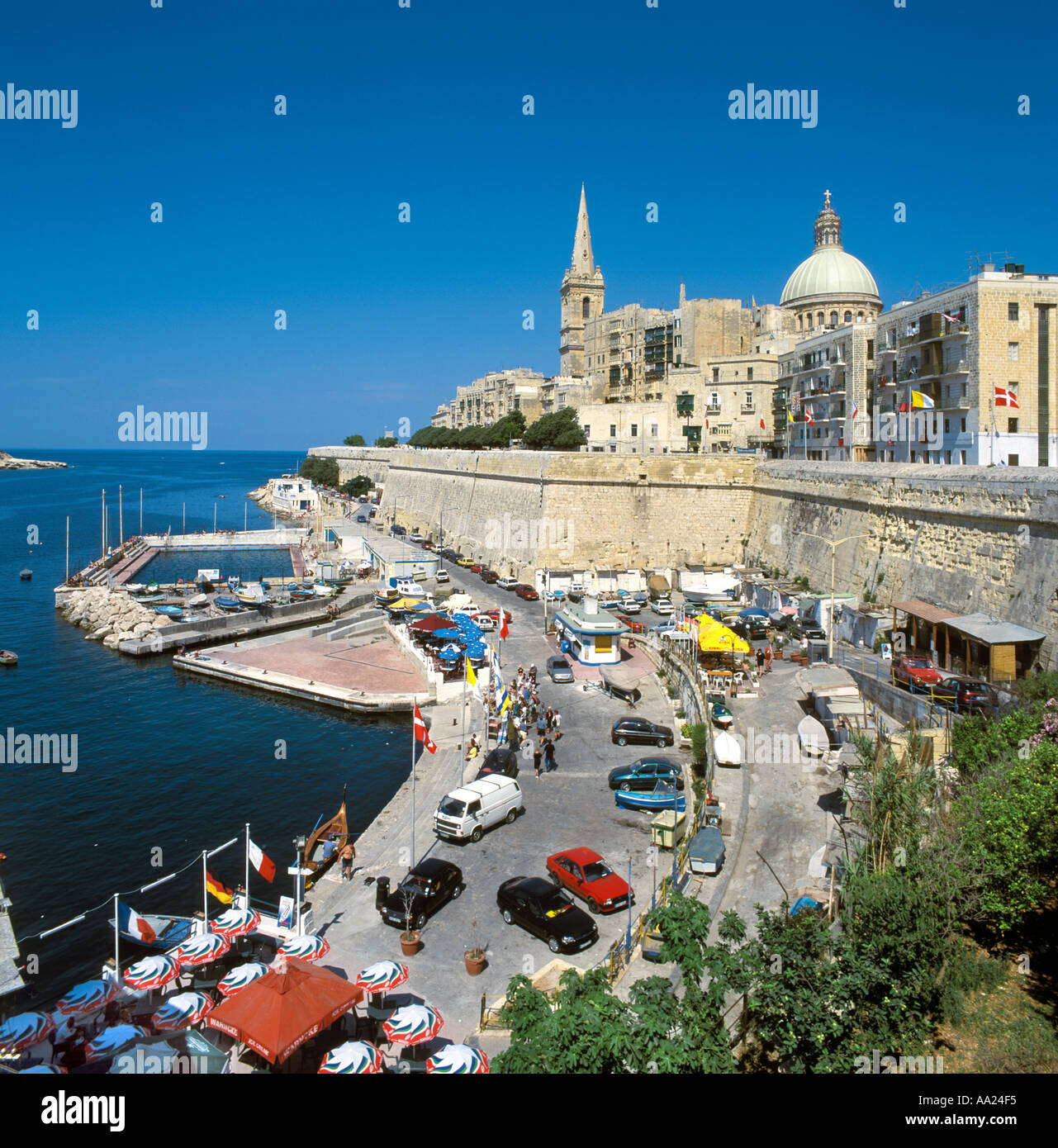 Seafront looking towards the old city with the dome of the Carmelite Church, Valletta, Malta Stock Photo
