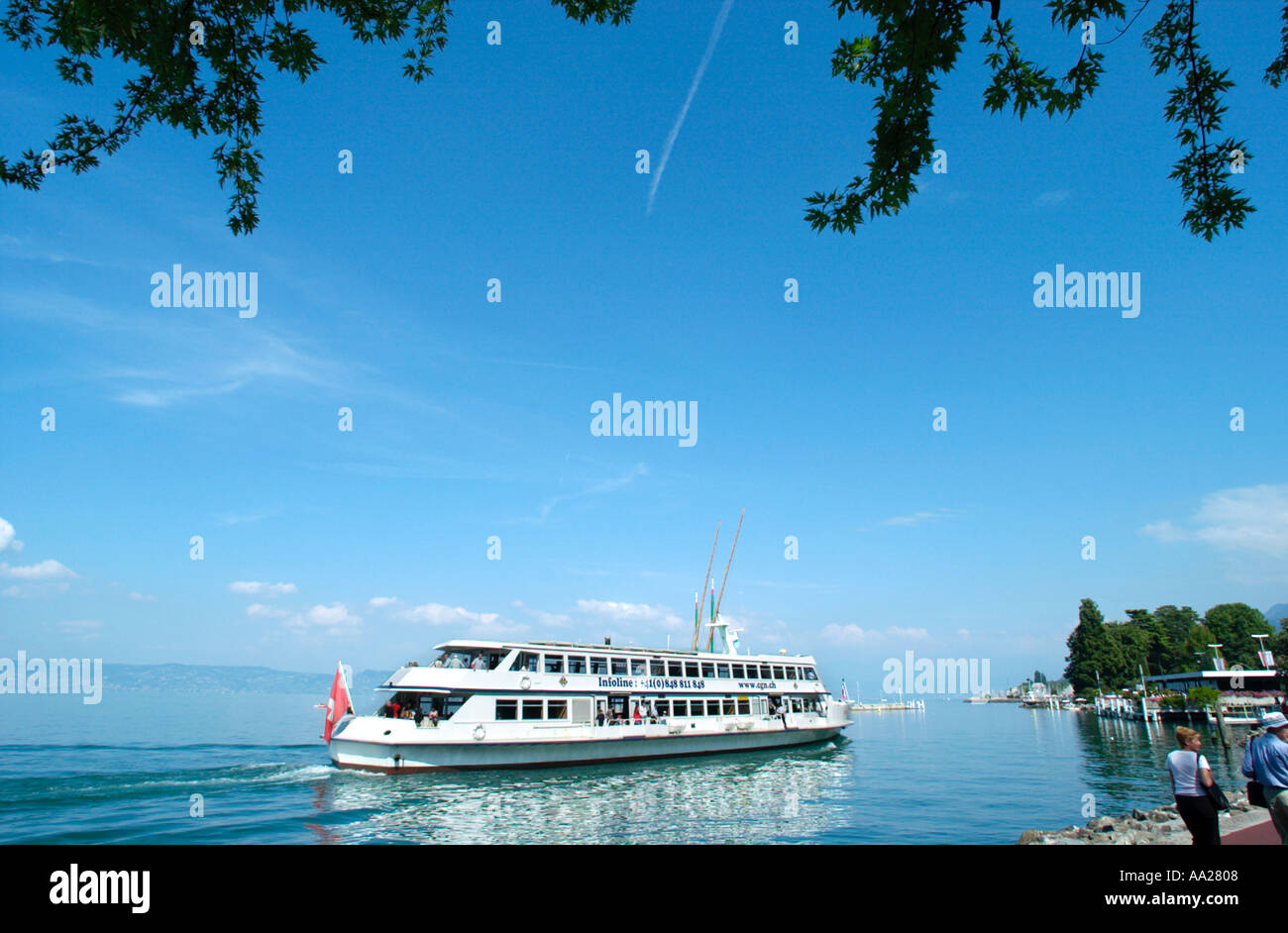 Cruise boat/ferry off the lakefront in Evian, Lake Geneva (Lac Leman), France - Stock Image