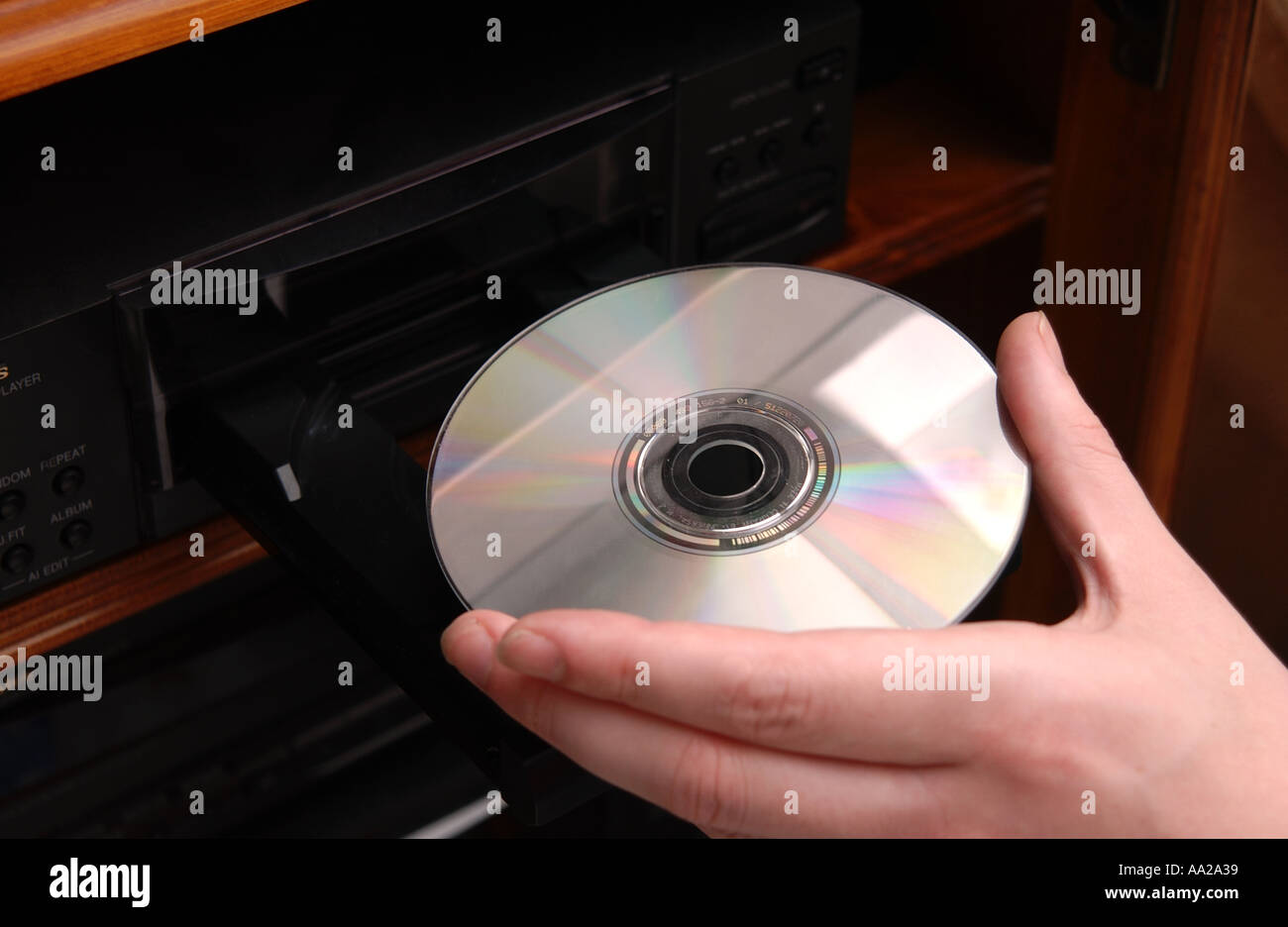 person putting cd into cd player stock photo 666169 alamy