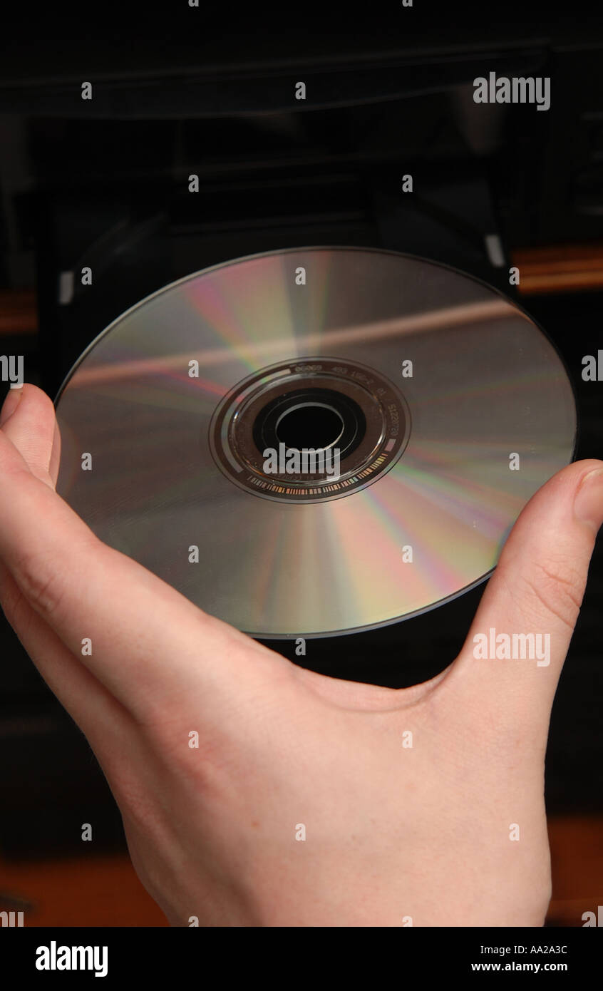 person putting cd into cd player stock photo 666172 alamy
