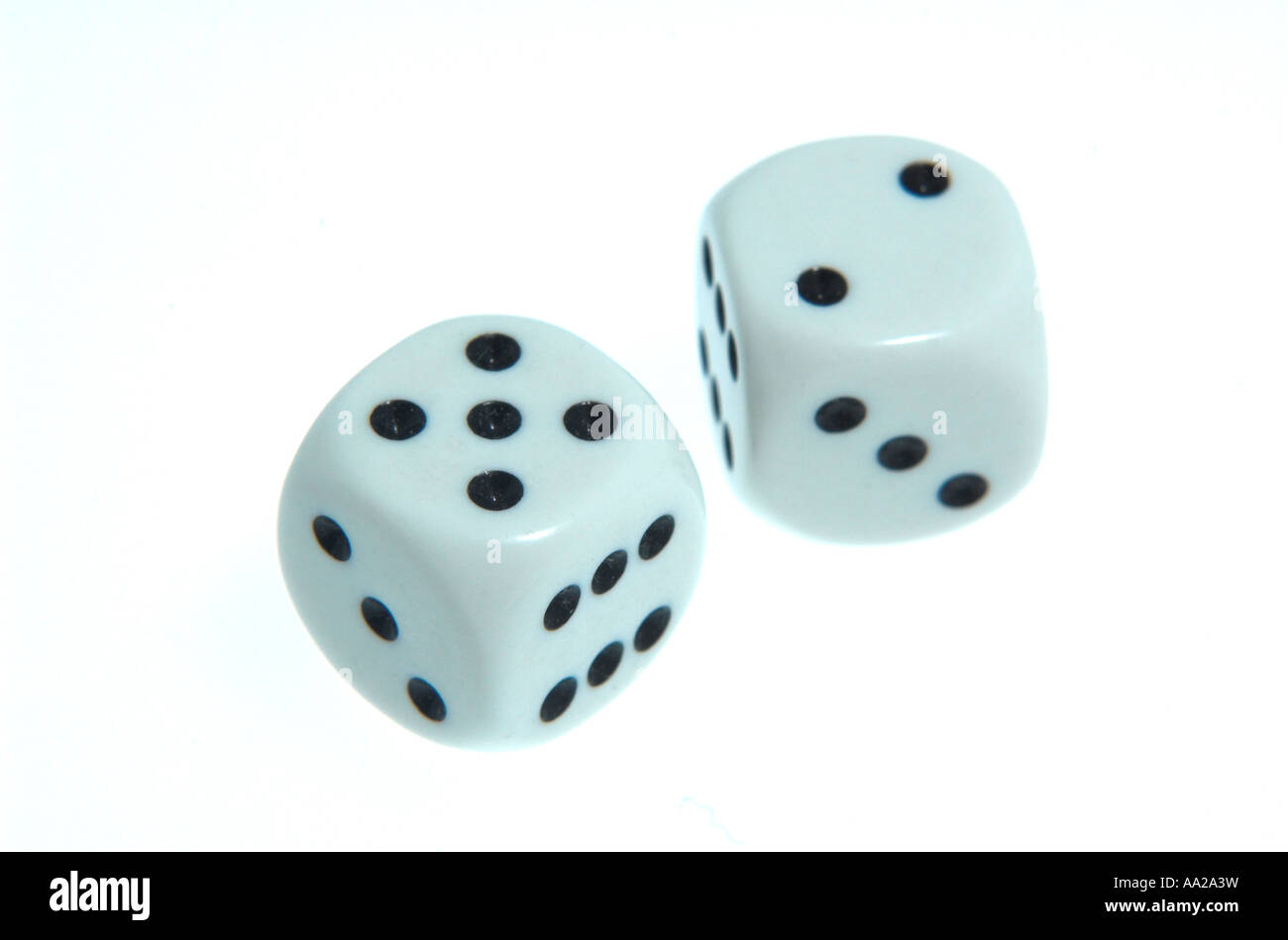 pair of white dice showing combo of numbers equal to seven - Stock Image