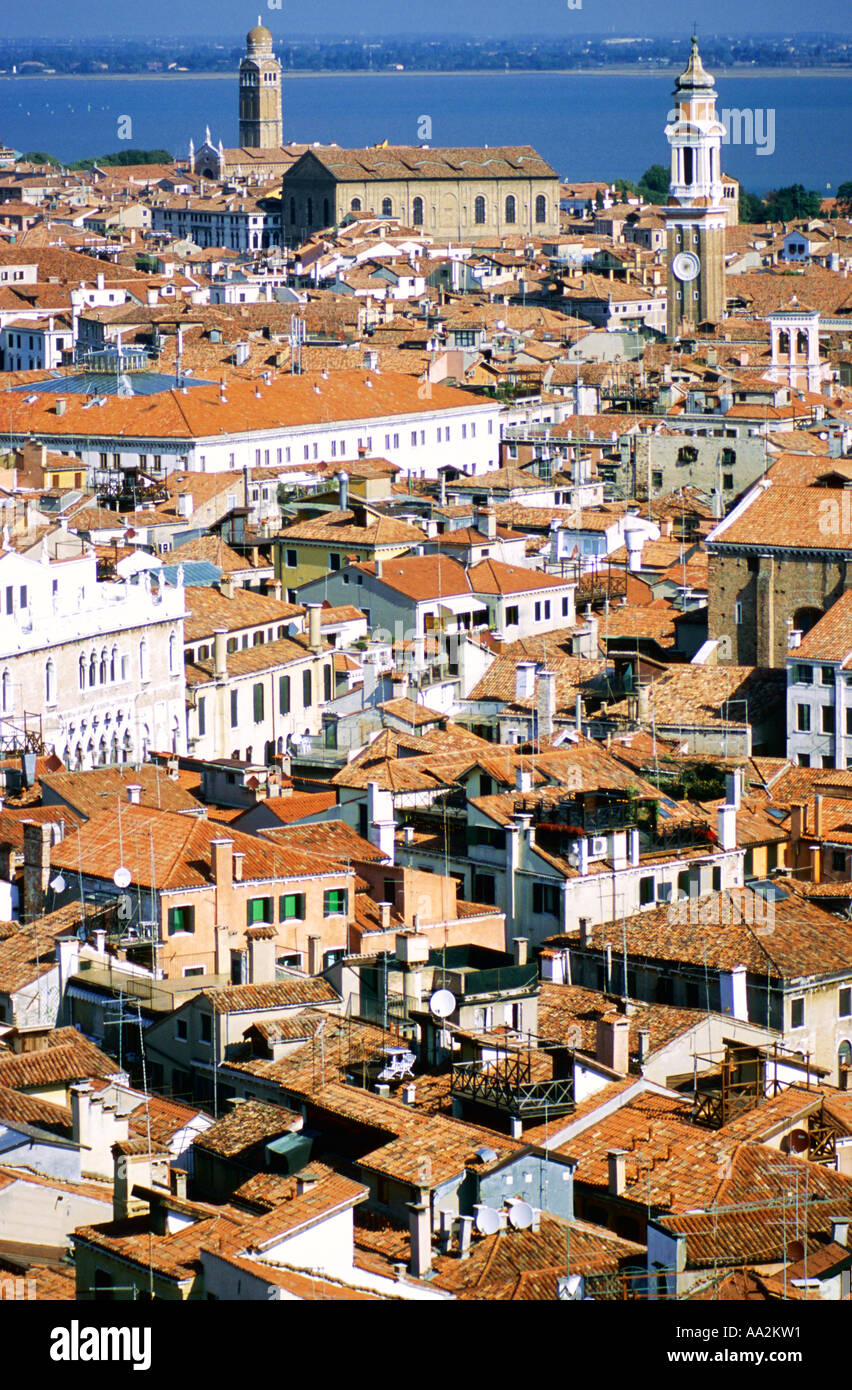 Italy, Venice, rooftops in sunlight with lagoon in distance, elevated view Stock Photo