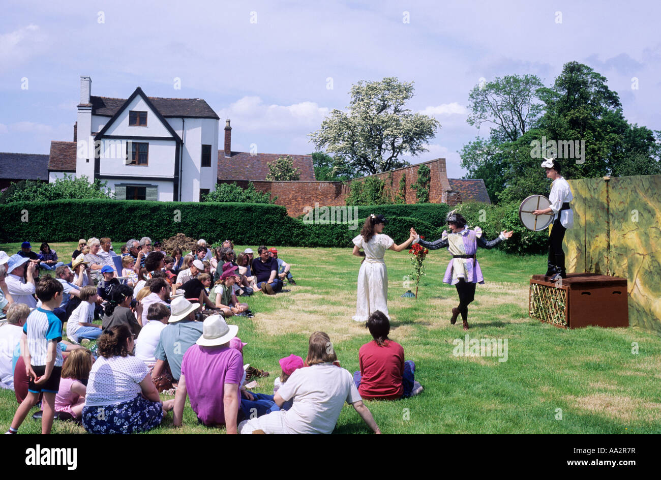 Open air theatre Shakespeare audience sitting on grass Actors Boscobel House, Shropshire, England, UK, performance, - Stock Image