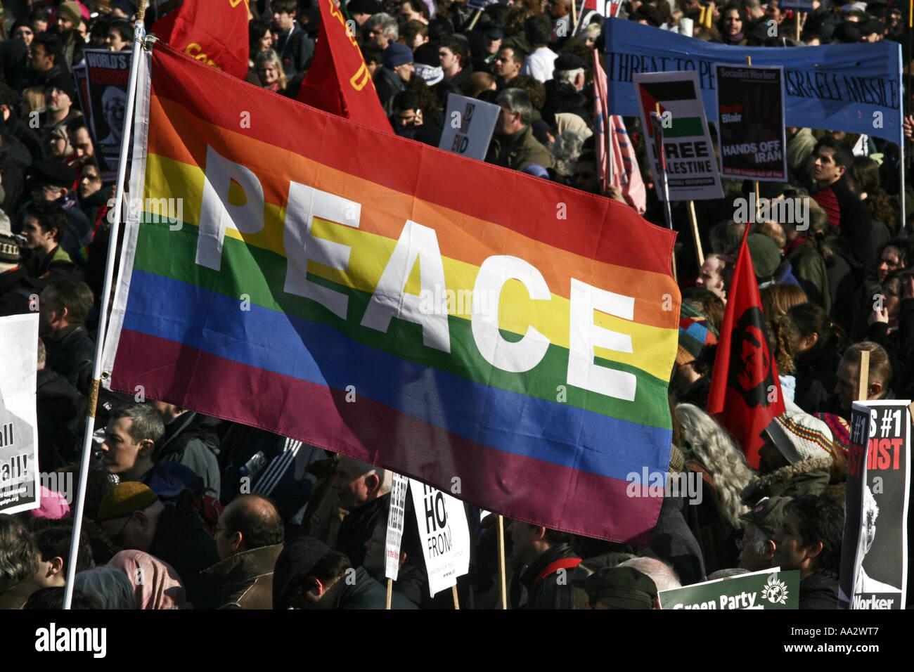 Peace flag at anti-war demo in London UK - Stock Image