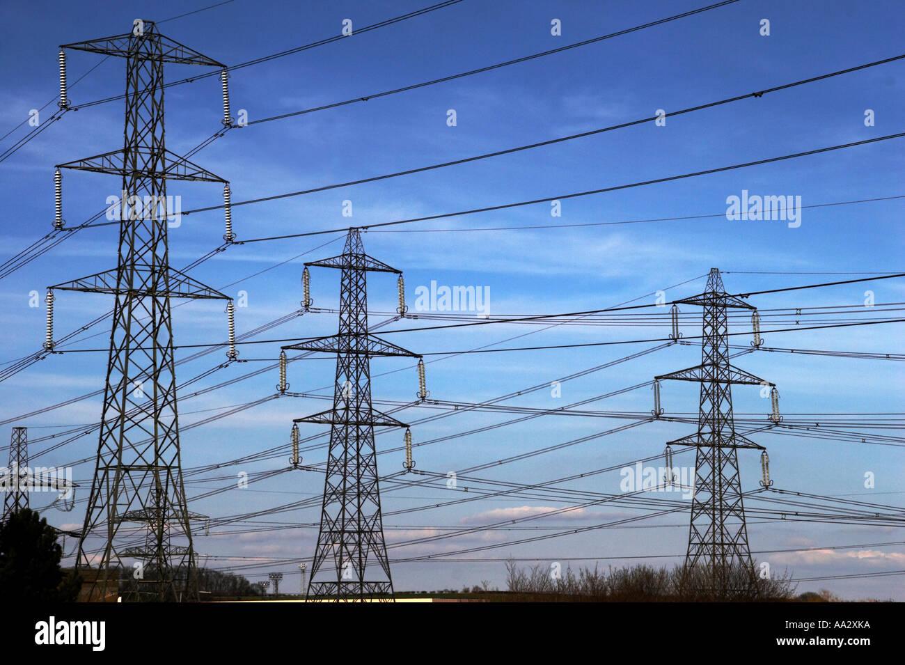electric pylons powerlines - Stock Image