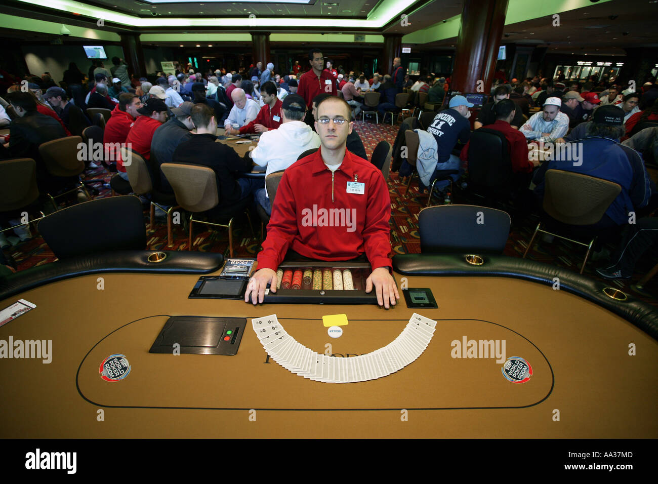 Poker dealer in the new Pker room at the Foxwoods Casino in Connecticut USA - Stock Image