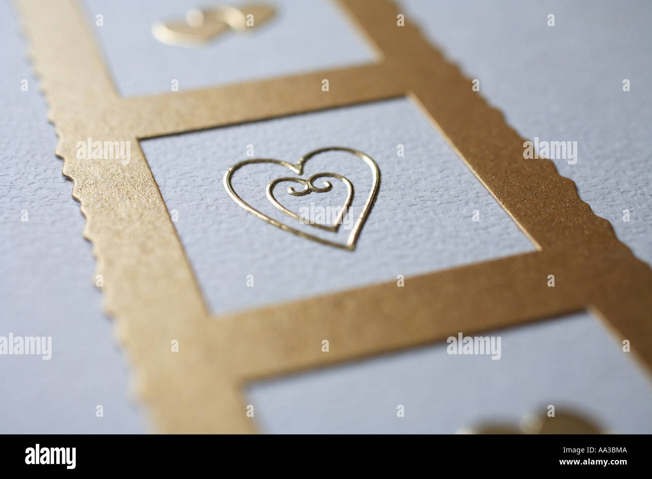 embossed heart on wedding stationary - Stock Image