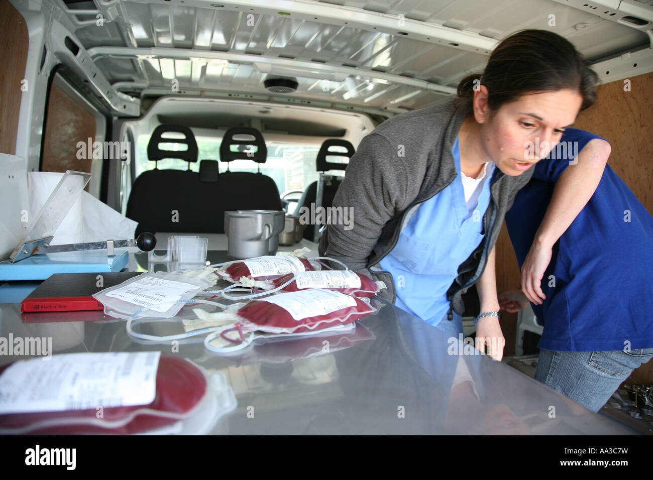 Blood In A Mobile Taking Van With Vet Walking Out Of The