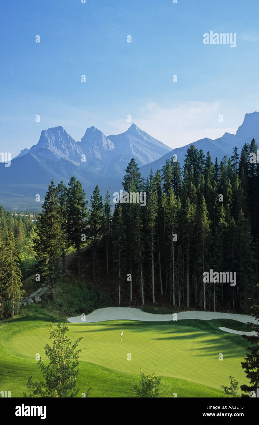 Silvertip Golf Course and the Three Sisters Mountains Canmore Alberta Canada - Stock Image