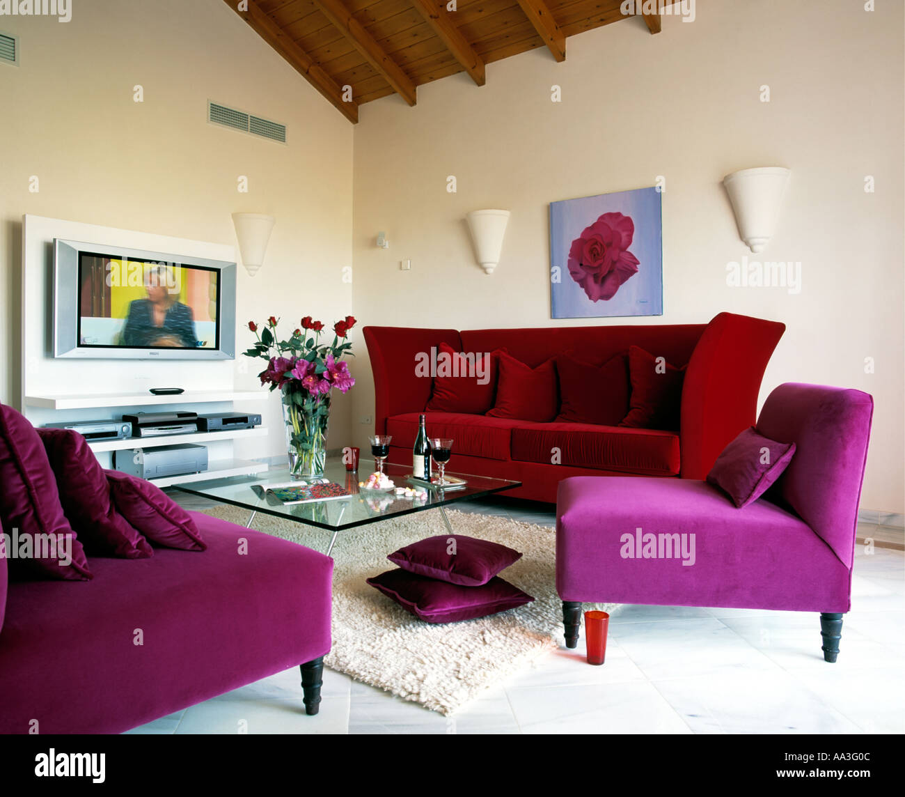 Purple Velour Chairs And Red Velour Sofa In Modern Spanish Living