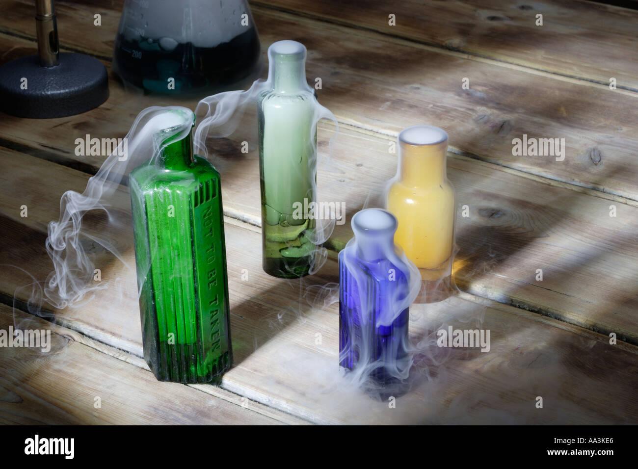 Potions smoking in laboratory - Stock Image