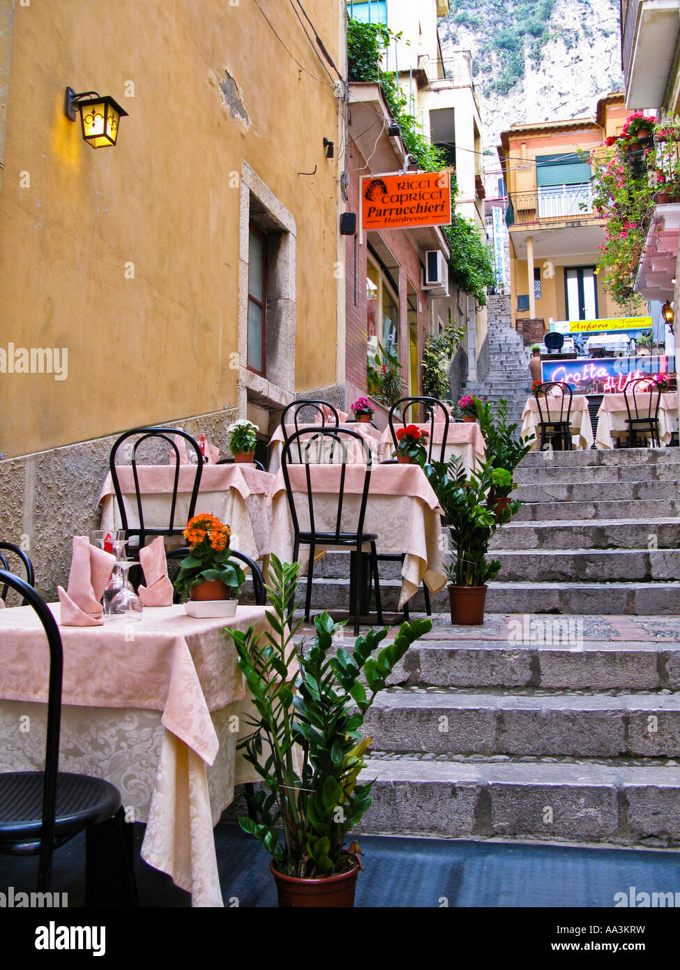 Restaurant tables on Salita Lucio Denti Taormina Sicily Italy - Stock Image