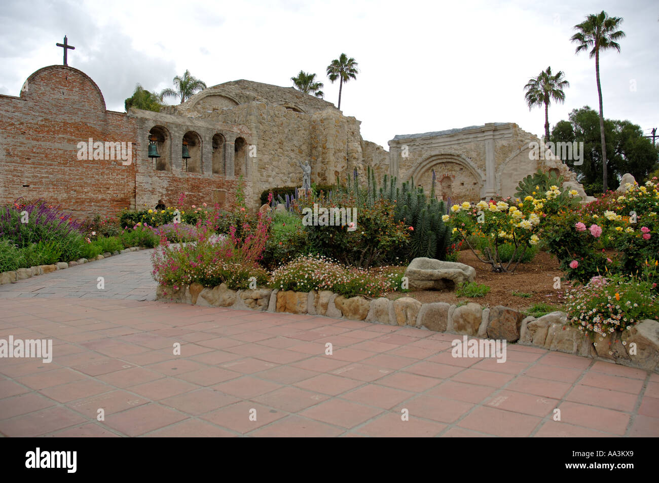 Sacred Garden, Bell Wall and Statue of Father Junipero Serra holding ...