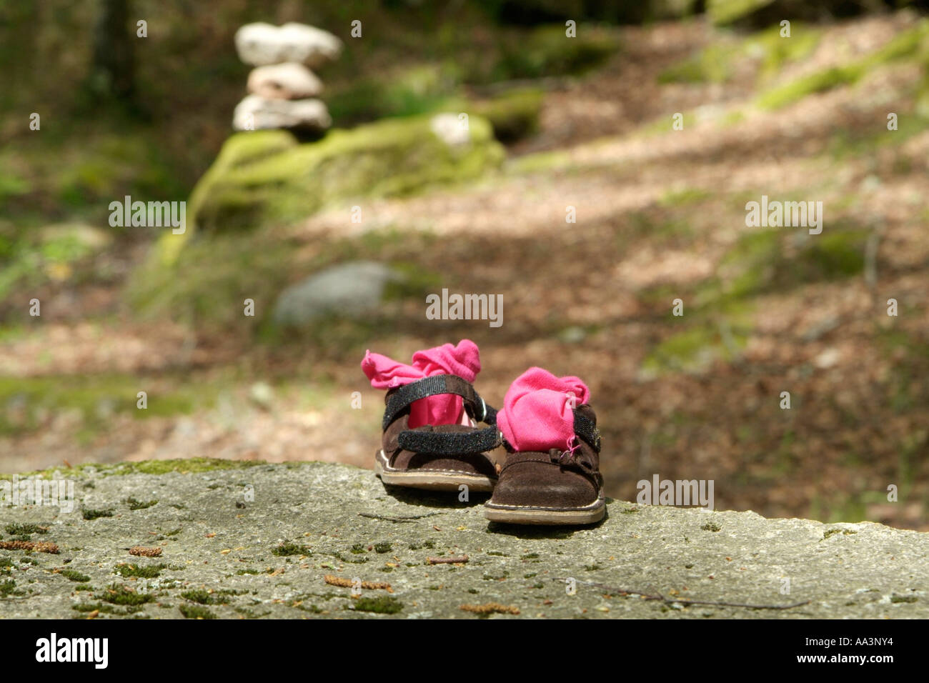 child shoes on the top of a stone Stock Photo