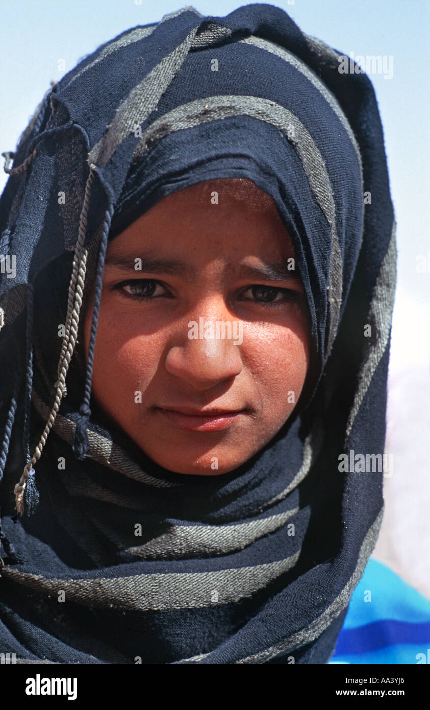 Portrait of a Bedouin girl wearing an indigo blue woven headscarf Sinai Egypt Middle East - Stock Image