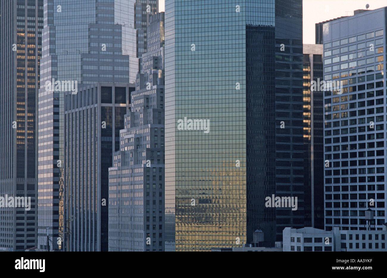 Facades of skyscrapers at the tip of Manhattan viewed from the Brooklyn Bridge Manhattan New York USA - Stock Image