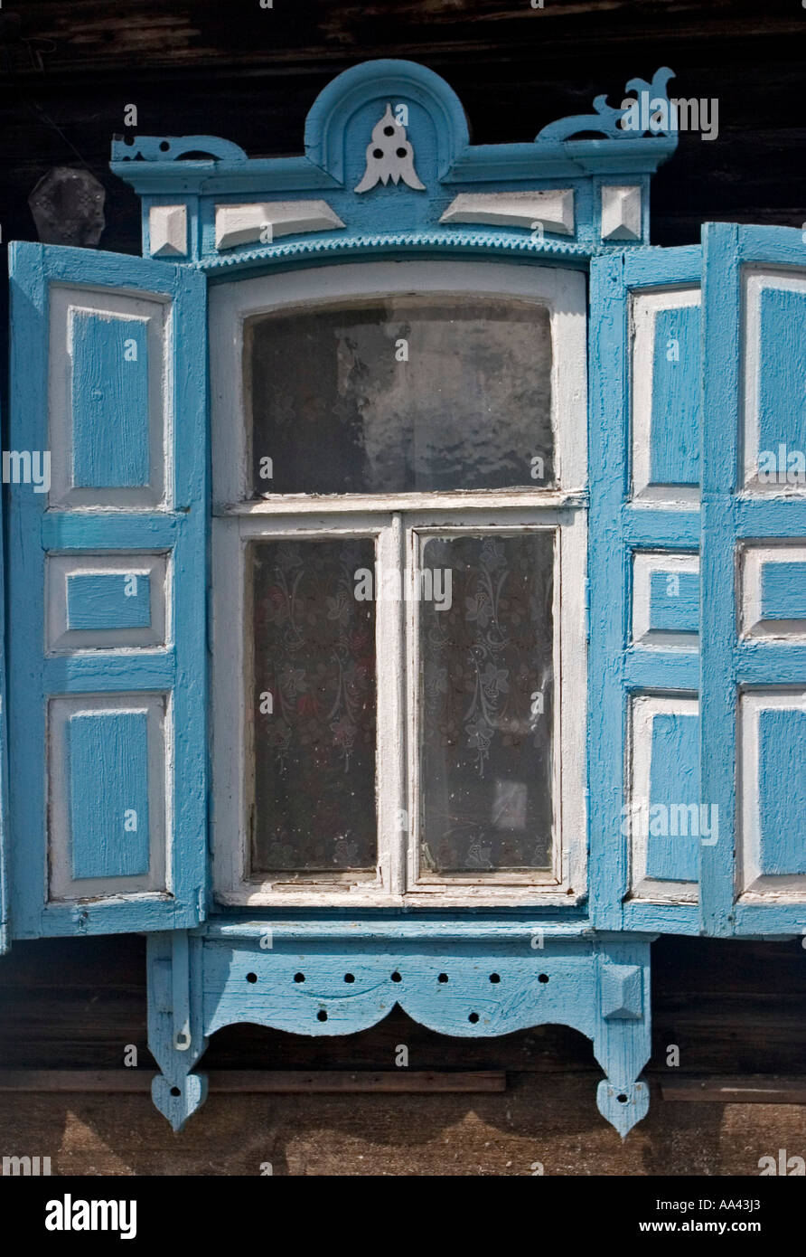 Windows with Ornamentic frames at different old Sibirian Wooden Houses, Omsk at the Rivers of Irtisch and Omka, Stock Photo