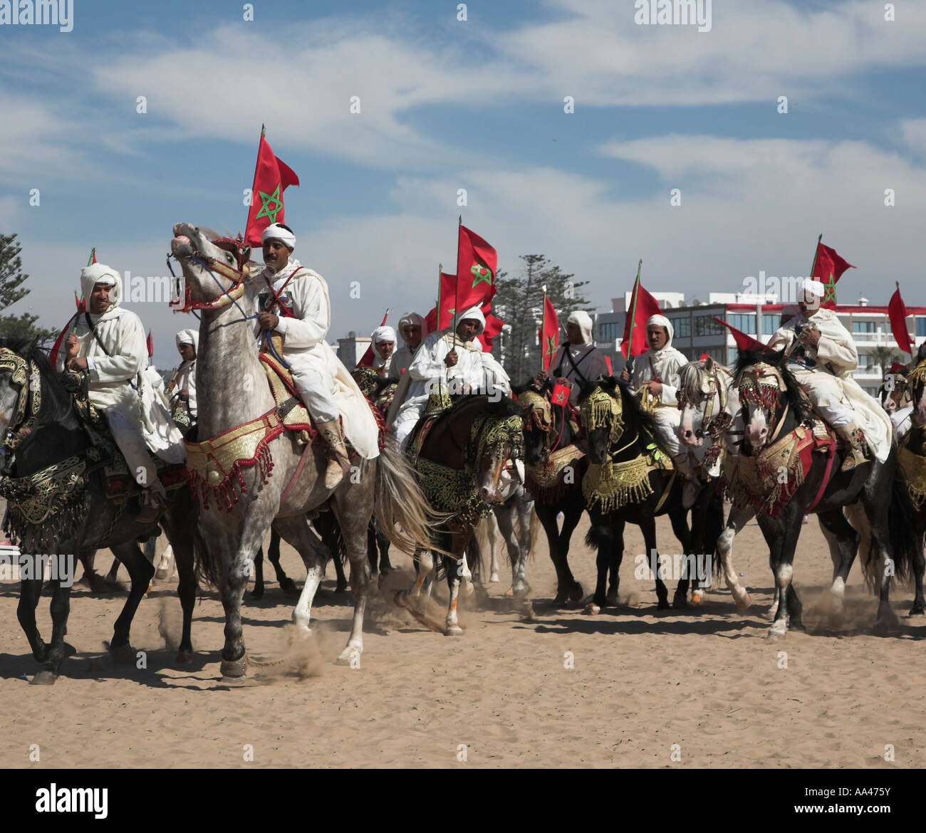 Horsemen In White Robes With Red Star National Flags On The Beach Stock Photo Alamy