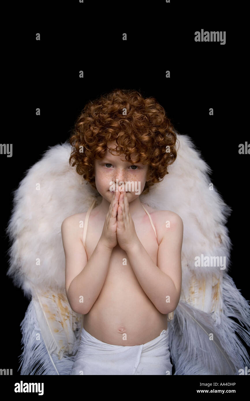 Child dressed in Angel s wings - Stock Image
