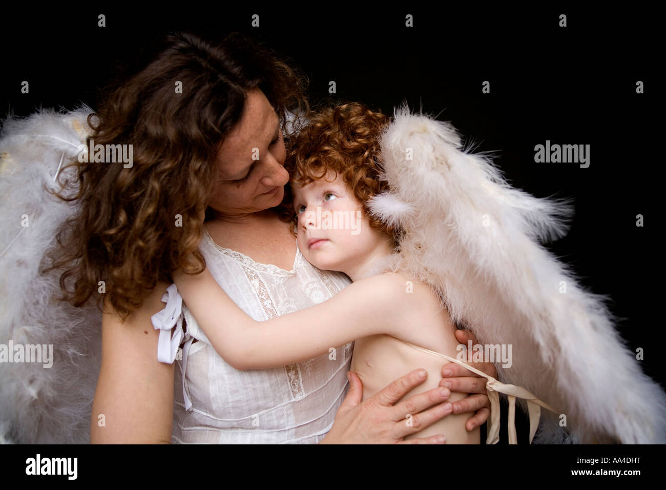 Mother and son with angel wings - Stock Image