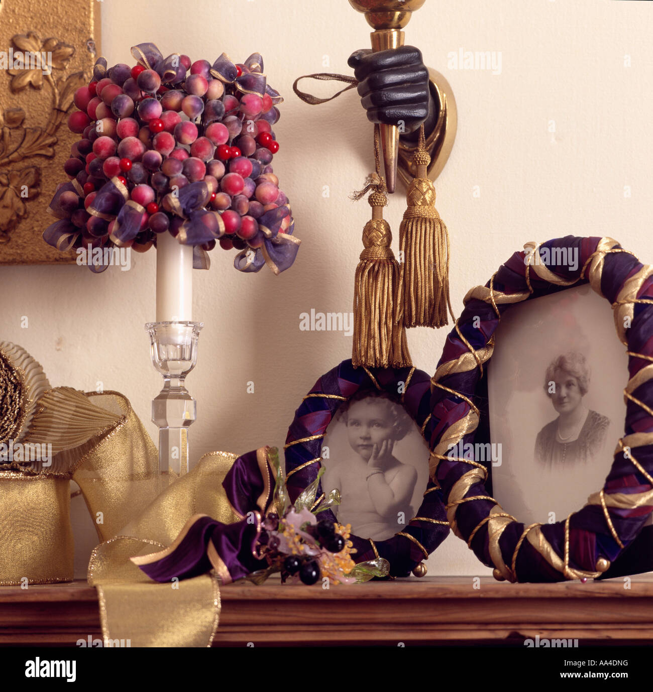 Purple And Gold Circular Photograph Frames On Shelf With Small Dried