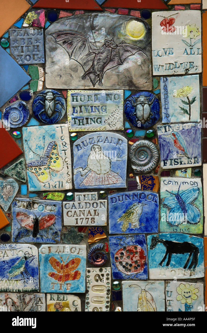 Tiles made by children in Consall village in English Midlands depicting the beauty of nature - Stock Image