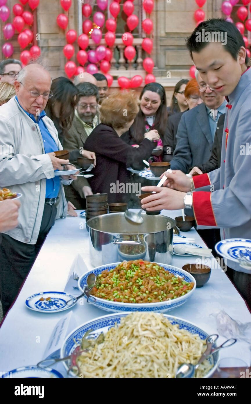 Paris France, People Helping Themselves to 'Chinese Food' at the Chinese Cultural Center 'Festival of Chinese Gastronomy' Table - Stock Image