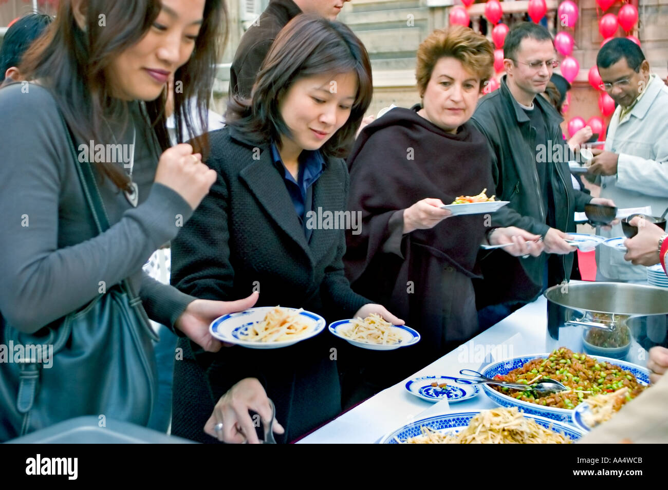 Multicultural, Paris France, Asian Women Serving Themselves Meals Chinese Gastronomy 'Chinese food' Buffet Table - Stock Image