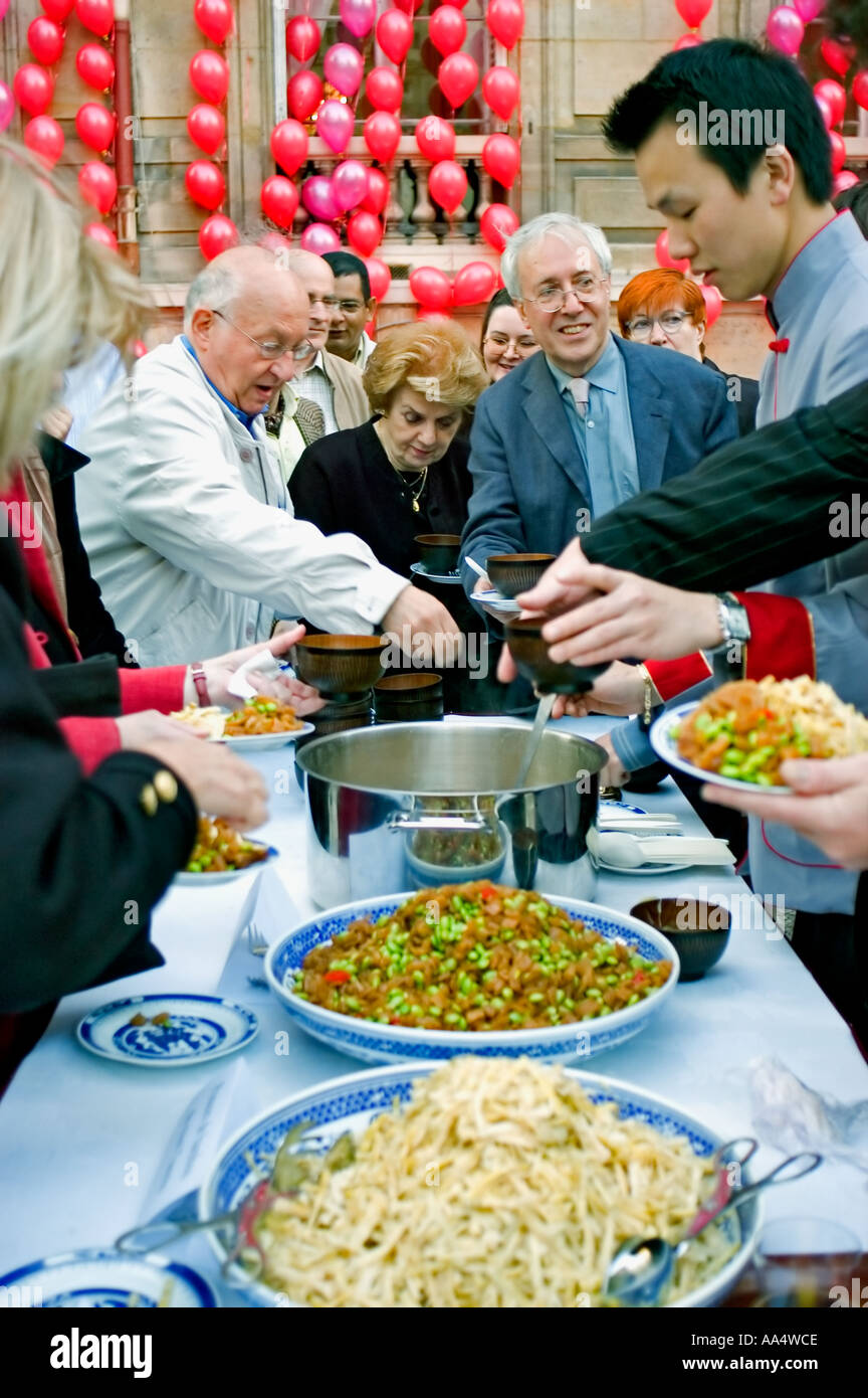 Paris France, People Serving Themselves to Chinese Food Buffet at the 'Chinese Cultural Center' New Years Celebrations events - Stock Image